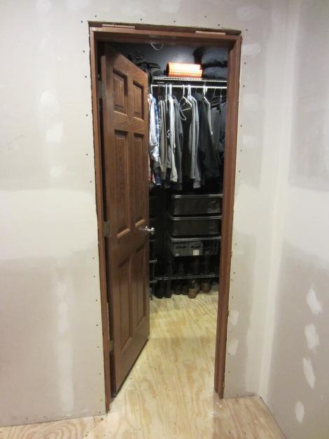 Closet door with casing