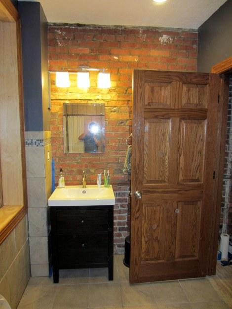 Oak door... Brick wall... Small Sink...